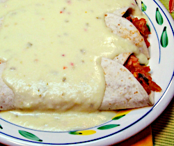 Chicken Enchiladas Smothered with Creamy Cheese Sauce