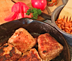Image of Breaded Pork Loin with Baked Beans and Sliced Tomatoes