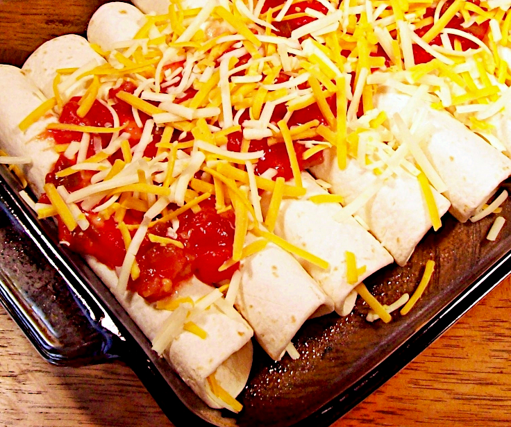 Image of Cheese Enchiladas with Rice and Beans