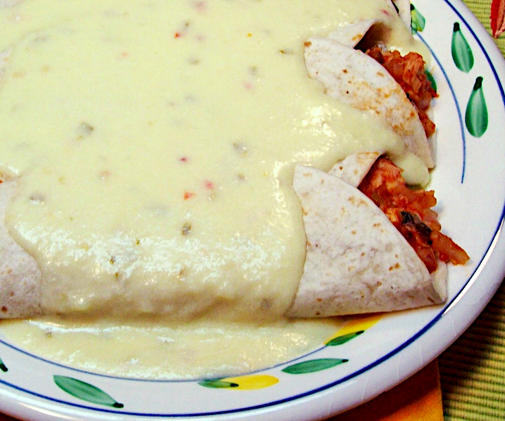 Image of Chicken Enchiladas Smothered with Creamy Cheese Sauce