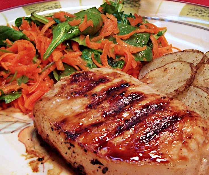 Image of Honey Marinated Pork Chops Potatoes with Carrots and Spinach Salad